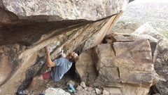 Towards the beginning of the route.  Gearing up to gain the lip (crux) and hold the swing.