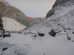 The left wall as you enter Protection Valley.  Super Lite (blue arrow), Mix Fix is in the deep gash (red arrow).