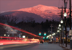 First light on Mt. Washington, as seen from 18 air-miles away in North Conway village.