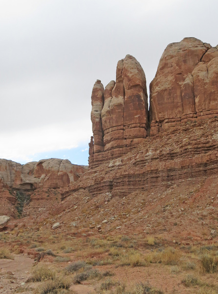 Trident Tower from a distance in the main wash of Roundhouse Canyon.