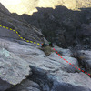 P2 belay. Yellow line = Slung Horn. Red line = Bowl Route.