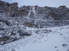 Climb the right side of the ice. Top of first pitch is a fixed pin anchor, all other anchors are v-threads.  Approximate belay positions marked.