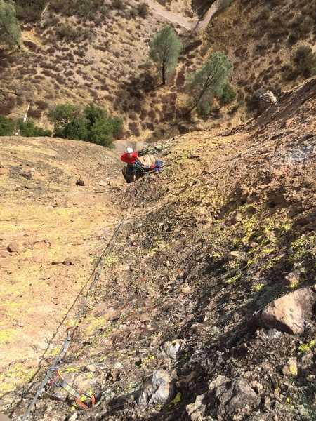 Looking down at the killer P2 belay on top of a HUGE loadstone.
