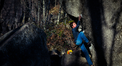 Jake climbing to the top of the Boxcar Arete on the Godzilla Boulder.