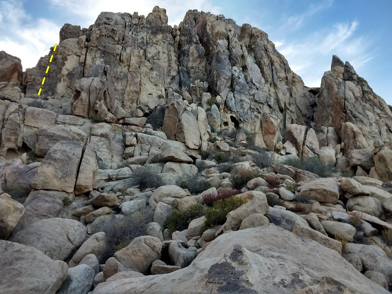 Looking up at Television Wall (left) on the approach talus.<br> Mr. Rogers drawn in dashed line for reference.