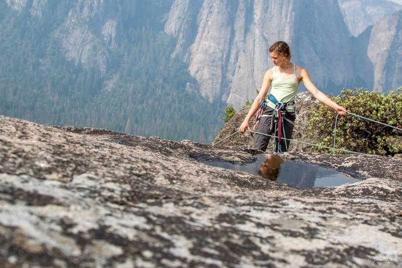 Best to extend your anchor and belay near the edge to see/hear your second