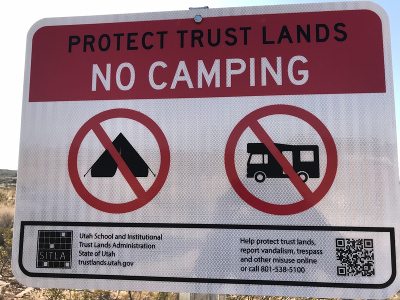 Do not camp where these signs are present. This includes the parking area of Moe's Valley.