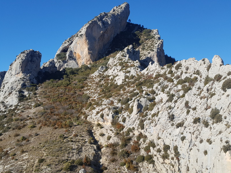 The main arch at El Forat dels Lladres can be seen in the left side of the center feature. The approach Trail can also be made out weaving its way to the Crag.
