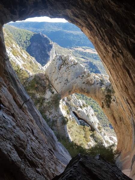 """Admiring The View down Valley from inside the highest cave at El Forat dels Lladres."""