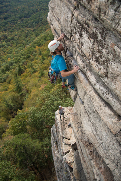 """Nick pulling just after pulling """"the move"""", with Becca at the belay."""