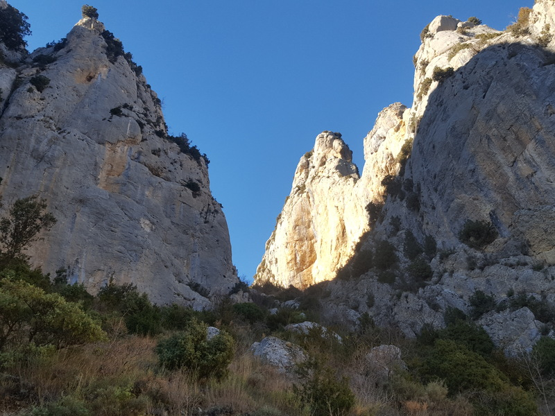This photo is from the S curve in the road  looking up at the approach Trail to Forat dels Lladres.