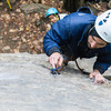 A careful watch of the belayer with a new leader.