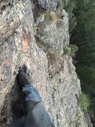 Looking down at the belay ledge above P1 - freesolo (windy).