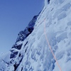 Scott Backes putting in a (perfectly useless) screw on the second pitch of Riptide on a -25C day.