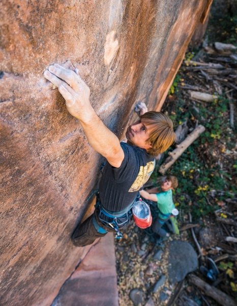 Damon Vaughn sticking the crux hold on Riptide. Photo by Jack Lester.