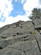 Stepping across the route into the leftmost crack which Kramar rates as 5.5.