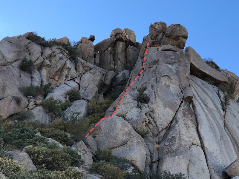 White on starts on top of the ledge (accessed from a trail  to it's left) and follows a discontinuous crack system to the left of the vegetation shown in about the middle of the buttress.  Beat Feet can also been seen here on the right side of the buttress.