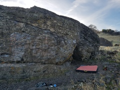 The right side of the boulder. The Bulge (V3) is right above the crash pad.