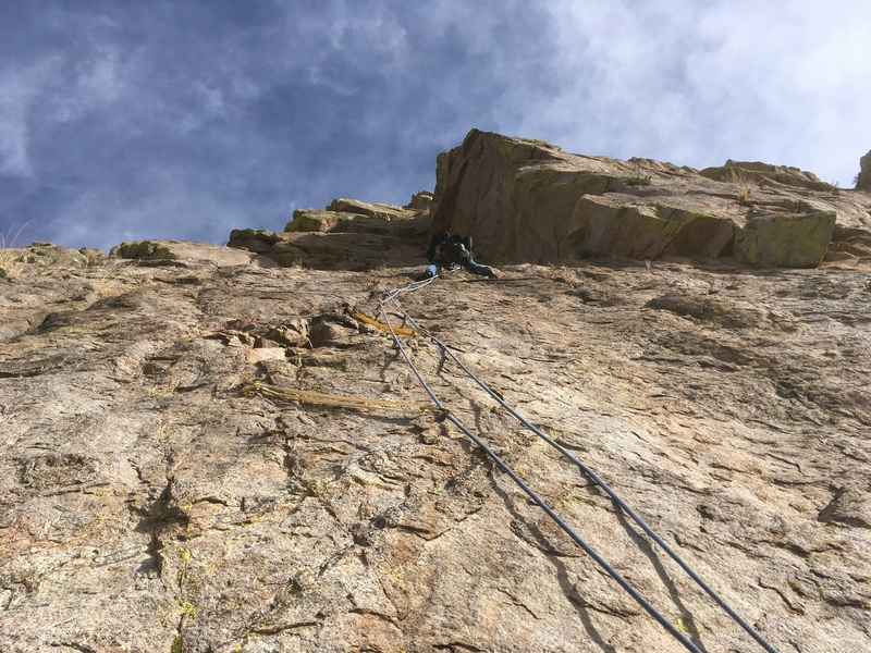 Forrest Wilcox leading the crux of the route on P2. The first piece of gear clipped here is an old rusty bolt.