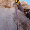 The first half of the route climbs patina on the arete.