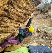 Back to the Gym first ascent. Feet on starting foot. Hand starting hold below the left hand.