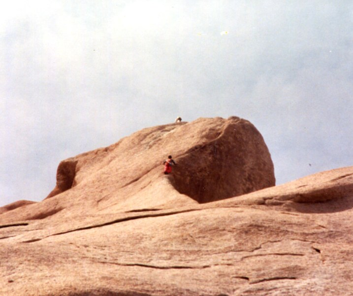 Ellen Holden on the edge of Trac II, Mike Hearn and Anna Houpt witnessing this final and successful attempt from the top.