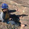 Oka demonstrating the body belay on the FA of the Meat Sweat route.