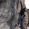 Jamie stabbing at the crux mono on Watt Rod, 5.12a at the AMC Wall in Spearfish Canyon.