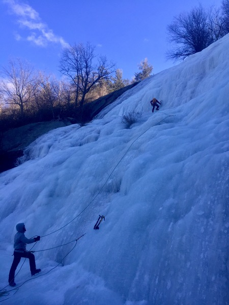 August leading up the big upper falls, belayed by Matthew.