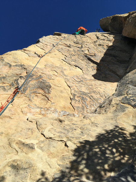 Jaeson nearing the top. It appears that many holds have broken off near the second bolt?