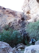 Looking up at the large, dark hueco and the real rock climbing on the route.