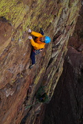 Delicate face climbing leads to the first high bolt. A decent offset Alien (green/yellow) helps protect the runout.