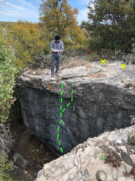 Standing above The Mangler, looking at heart rock. Bolts are 10' back and finish can be straight over or right.