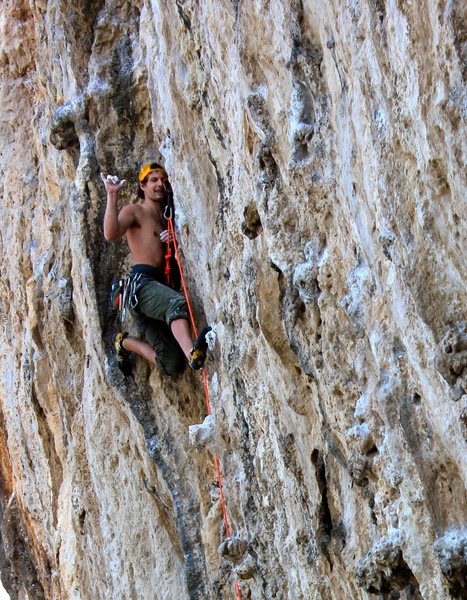 Forcing a smile. No hands rest before the crux, still strenuous but necessary :D