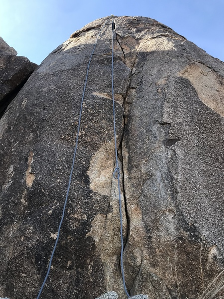 Route shown here. Up hill and NW of fear rock.  The crack is very obvious when standing on top of FR.