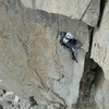 Looking down at pitch 9.  Be weary of the sharp edge above the climber if you link it into pitch 10