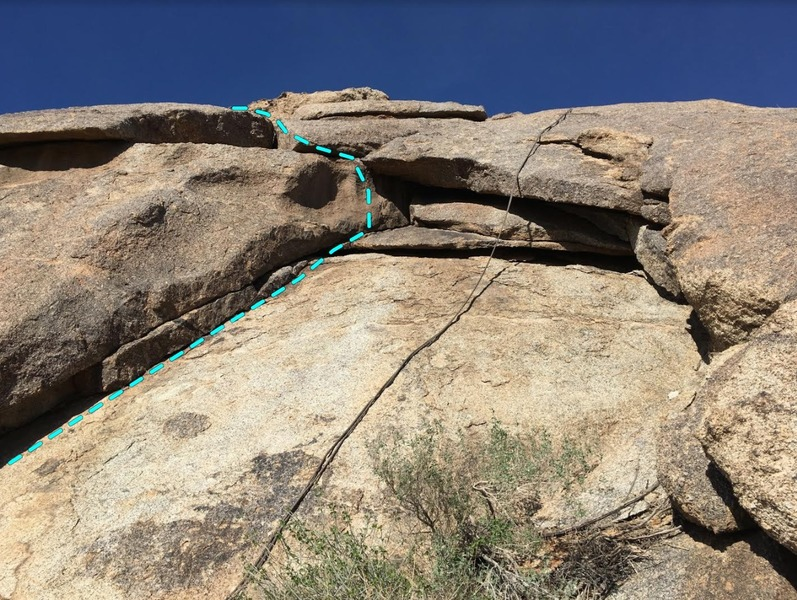 Crazy Handfull of Nothin climbs the left crack and over the overhang to the anchors up left shared with Blue Sky.