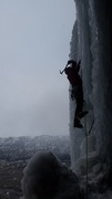 John traversing out from the belay cave on Miami Ice.