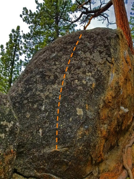 Here you can see the boulder in its entirety.It starts with a high foot on a juggy rail, a low right hand undercling, and a high left hand sidepull. There are several crimps mid route and a slopey, moss covered last hold and finish. The entire left arete is off, as well as the lowest section of the rock below the start.