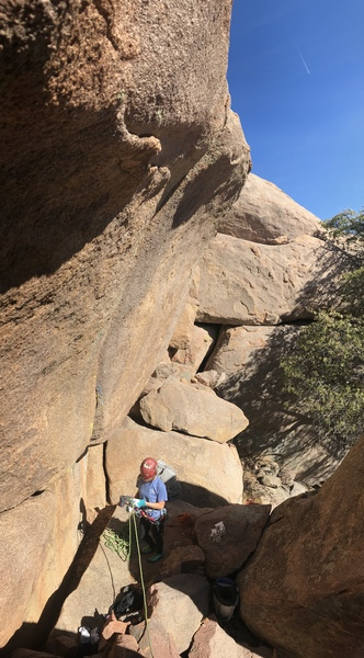 Route overhangs gently. A. Nachman at the base, in the belay nook.