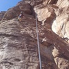 Top roping Sunny Side Up.  Route follows up left under the big bulge.