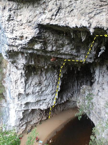 """The line of """"La serpiente cosmica"""". The person on the left is climbing """"Helldorado""""."""