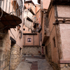 The streets of Albarracin. Many of the buildings are cantilevered out over the streets below to maximize space on the upper floors, the result is narrow streets which are overhung by the buildings above.