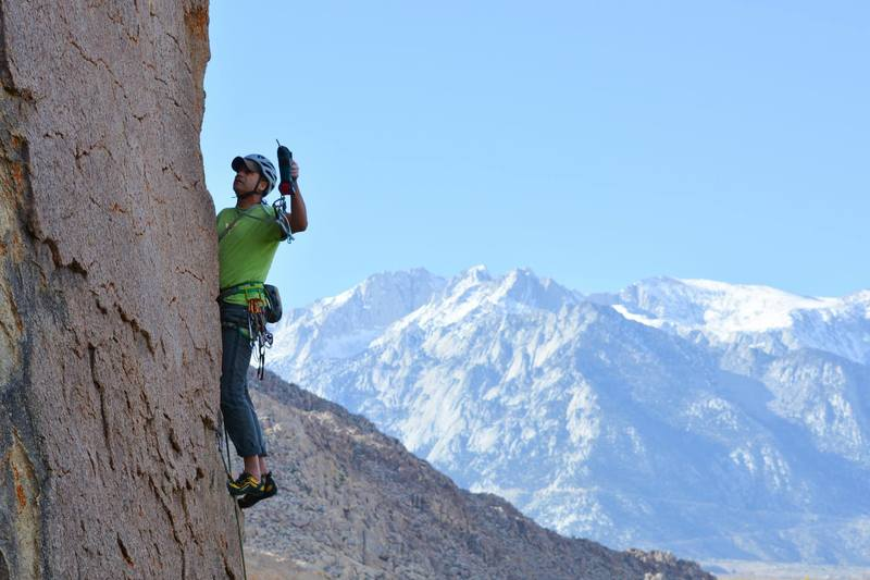 Dave Daly putting in the stainless steel during the FA of 'Shit Howdy' (5.9). Photo credits Mungeclimber