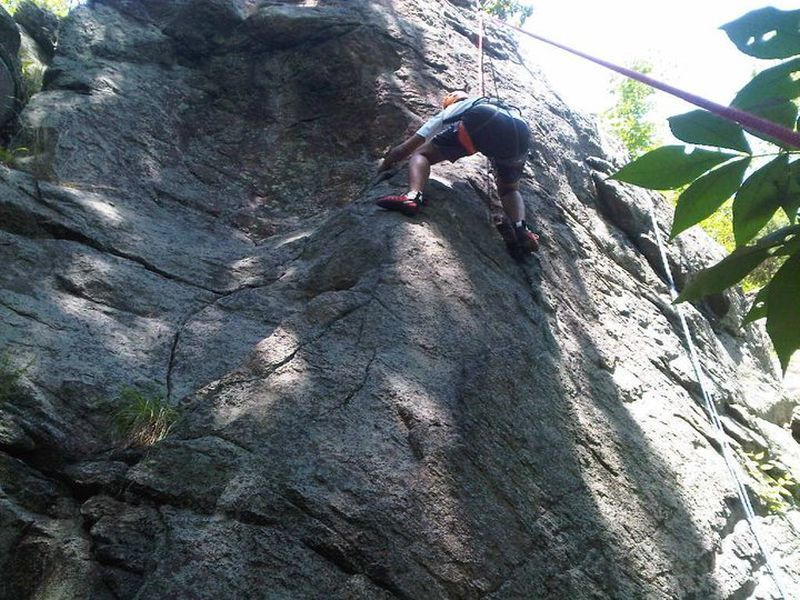 A client attempting to traverse to the false arete climb.