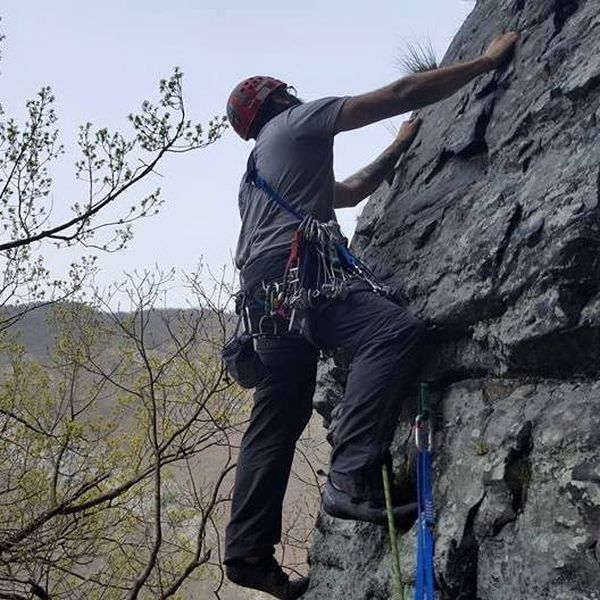 """Joey Vulpis leading the """"The Rib"""" about 75 feet into the route just below the belay ledge."""
