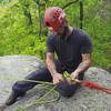 Joey Vulpis from Northeast Mountain Guiding on top of the Lead Wall setting up anchors.