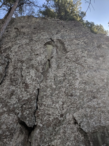 Climbs the crack up to bolted anchors
