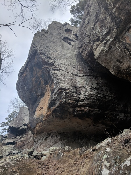 Climb the face at the edge of the large cave