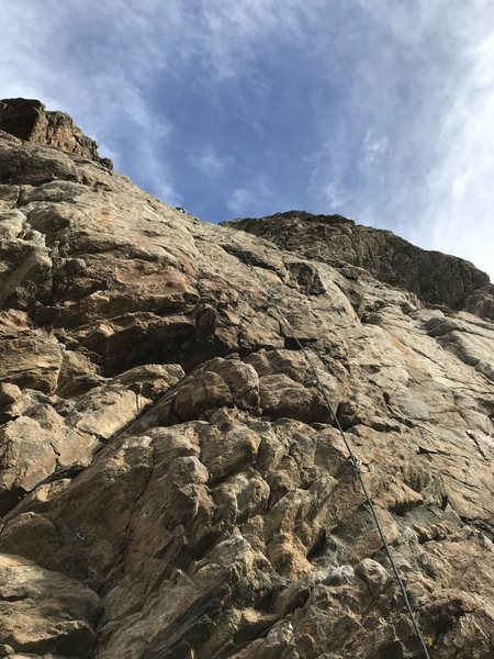 A shot from the ground, notice the high second bolt. It is very easy climbing to there.